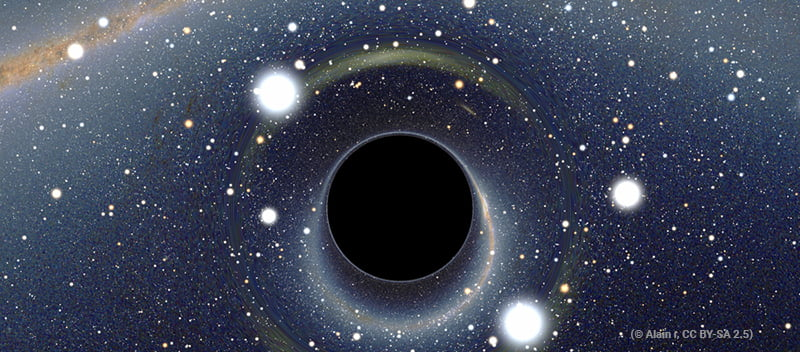 artist's view of a black hole in space