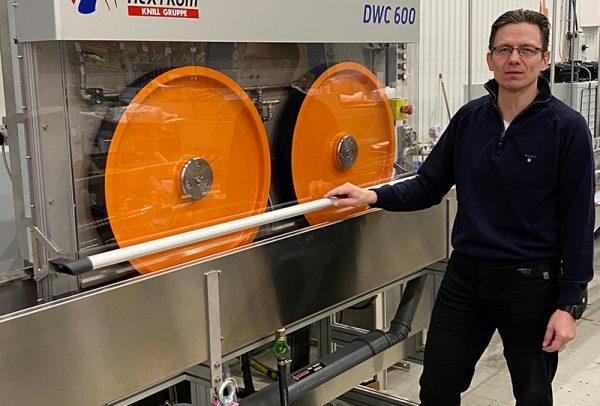 Mika Vihavainen standing next to DWC 600 Dual Wheel Capstan